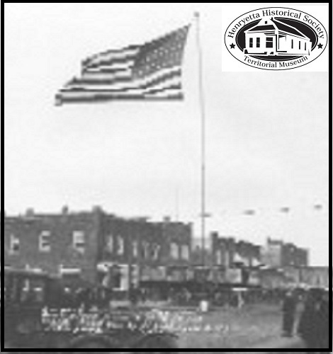 Largest American Flag that ever flew from a pole, at that time. Over 700 square feet of bunting. Donated to Henryetta, OKlahoma, by Lyman C. Hill