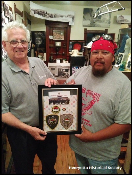 May 22, 2017 Mike Doak, Henryetta Historical Society President and Charles Bronco, Oklahoma Indian Bikers review the Creek Indian National Honor Guard exhibit in the Henryetta Territorial Museum.