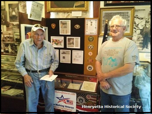 Will Frank Lowery WW II Army-Air Corps Pilot returns to his child-hood home and tours the Henryetta Territorial Museum with Henryetta Historical Society President, Mike Doak.