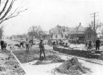 Workers laying brick road, Henryetta, OK