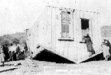 Home turned over by tornado. Late 1930's. Henryetta, Oklahoma